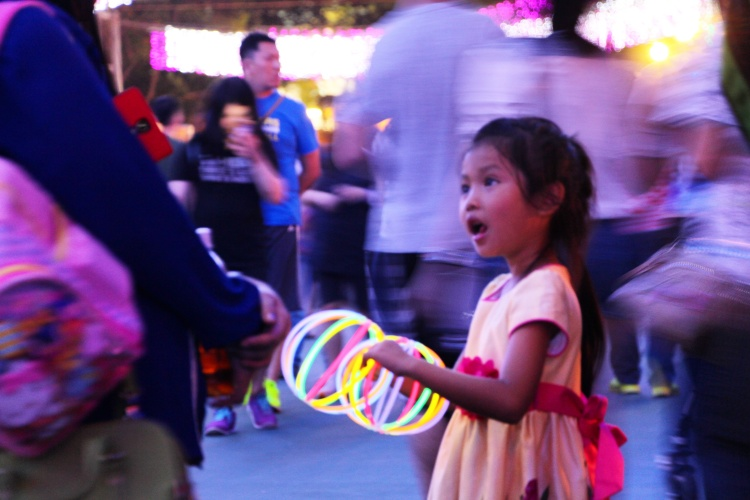 Girl with glow sticks. | Urban Mid-Autumn Lantern Carnival, Victoria Park, Hong Kong | September 27, 2015 | Tanya McGovern
