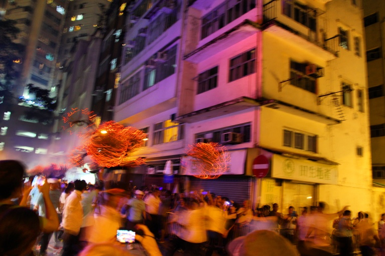 The Tai Hang Fire Dragon darts through the streets of suburban Tai Hang. | Tai Hang Fire Dragon Dance, Tai Hang, Hong Kong | September 27, 2015 | Tanya McGovern