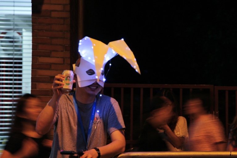 Man with mask poses with beer. | Tai Hang Fire Dragon Dance, Tai Hang, Hong Kong | September 27, 2015 | Tanya McGovern