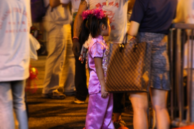 Young performer waits for her turn. | Tai Hang Fire Dragon Dance, Tai Hang, Hong Kong | September 27, 2015 | Tanya McGovern