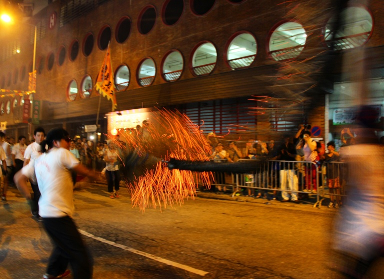 Fire dragon darts through the streets of Tai Hang | Tai Hang Fire Dragon Dance, Tai Hang, Hong Kong | September 27, 2015 | Tanya McGovern