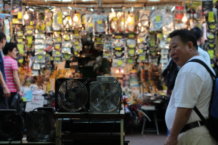 Man browses stalls along the Apliu Street electronic market. | Tanya McGovern