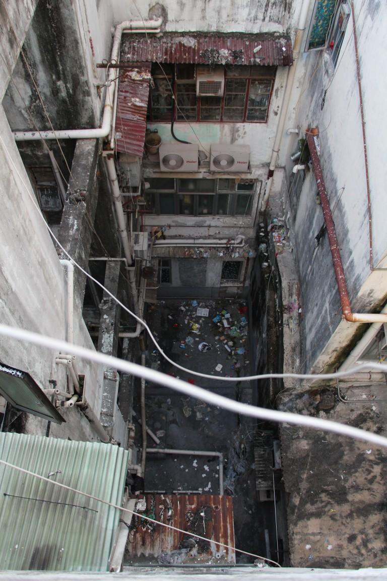 Garbage litters the space between buildings. | Tanya McGovern