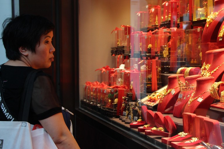 A jewelry store below Mr Yu and Ushanthan's housing complex sells ornaments and jewelry made of gold. | Tanya McGovern