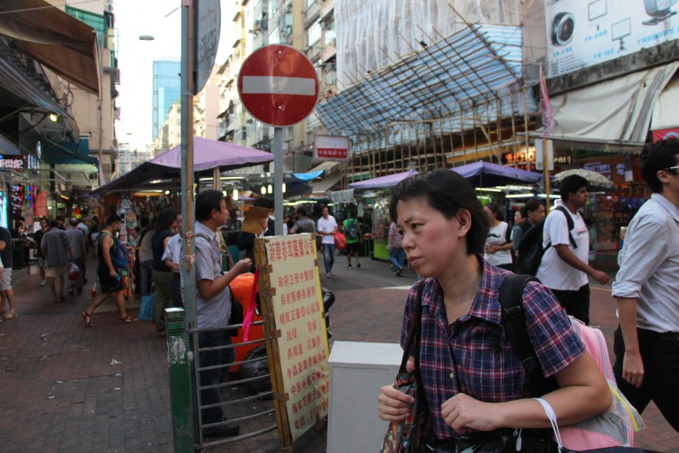 Woman walks through the streets of Sham Shui Po. | Tanya McGovern